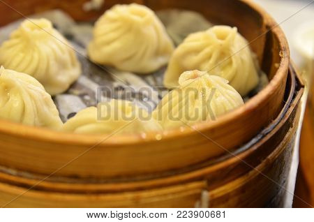 Traditional soup dumpling Xiao Long Bao is a popular Shanghai Chinese dim sum steamed in bamboo steamers.