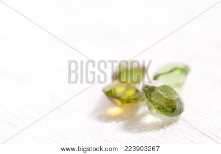 tourmaline cut gemstone crystals on a white background