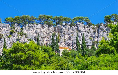 Hidden House Inside The Cliff In Croatia During Summer