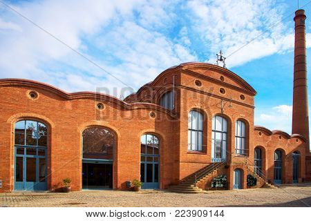TERRASSA, SPAIN - DECEMBER 26, 2017: The modernist building Vapor Aymerich, built in 1909, formerly a textile factory and nowadays the seat of the Museum of Science and Industry of Catalonia