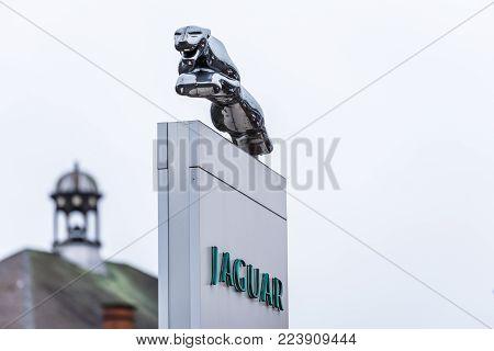 Northampton UK January 11 2018: Jaguar logo sign stand in Northampton Town Centre.