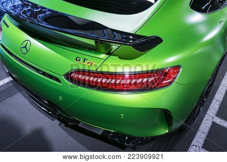 Sankt-Petersburg, Russia, January 12, 2018 : Green Mercedes-Benz AMG GTR 2018 V8 Bi-turbo exterior details. Back view. Car exterior details