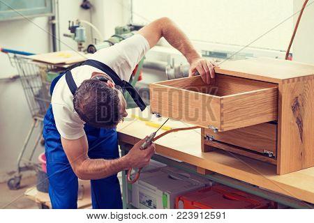 Worker In A Carpenter's Workshop