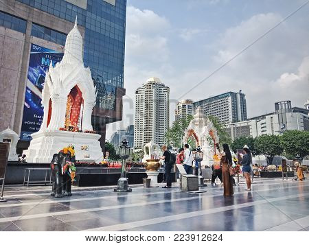 Bangkok, Thailand - January 26, 2018 : Trimurti statue and disciple at Central world