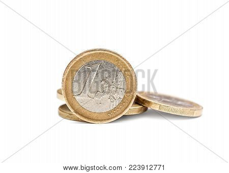 One euro coin with heap of euro coins.