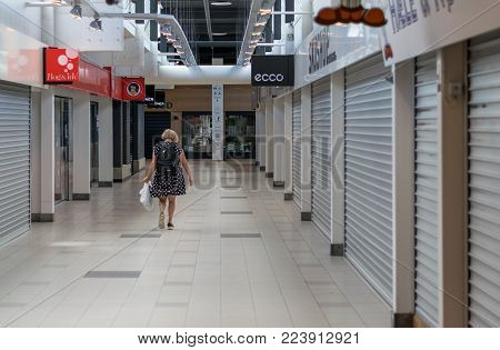 VIBORG, DENMARK -  AUGUST 14, 2016: An unidentified woman walking on in a closed mall in Viborg, Denmark.