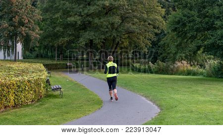 VIBORG, DENMARK -  SEPTEMBER 17, 2016: An unidentified woman running in Viborg, Denmark.