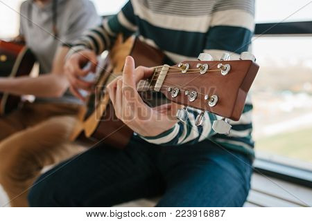 Learning to play the guitar. Music education and extracurricular lessons. Hobbies and enthusiasm for playing guitar and singing songs. To have fun.