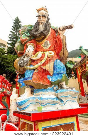 Close up of red statue in Tin Hau Temple Repulse Bay in Hong Kong
