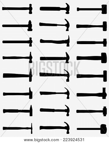 Black silhouettes of hammer on a gray background