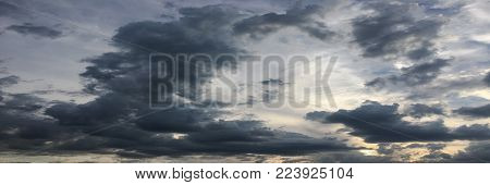 Beautiful stormy sky with clouds background. Dark sky with clouds weather nature cloud storm. Dark storm sky with clouds and sun