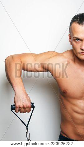 Half body of muscular man witj expander