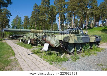 PAROLA, FINLAND - JUNE 10, 2017: Soviet T-72M1 tank with a mechanical mine trawl in the tank museum exposition in the sunny day