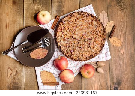 Tasty homemade apple pie Apple pie Apples Cinnamon Plate Napkin Wooden background Top view Horizontal photo