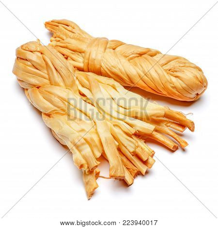Smoked braided cheese isolated on white background