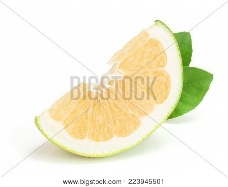 slices of Citrus Sweetie or Pomelit, oroblanco with leaf isolated on white background close-up.