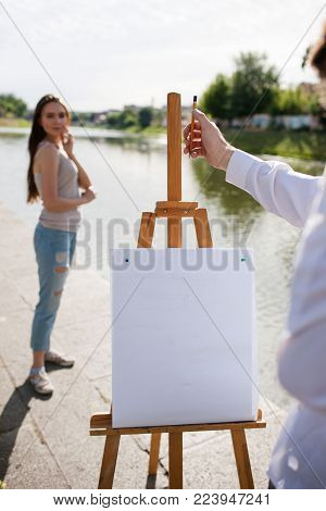 Artist woman portrait posing city concept. Lifestyle of talented people. Process of proportioning