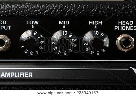 Closeup of the controls of a guitar amplifier.