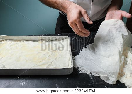 Food pastry. Baker works with baklava dough. Chef cooks dessert at a restaurant