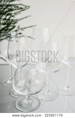 Crystal clear wine and cognac or brandy glasses on white background. Festive celebration or banquet party concept