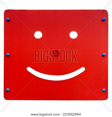 Smiling face carved on wooden surface isolated on a white background with clipping paths