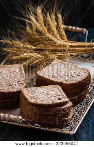 Freshly Sliced Whole Wheat Bread With Ears Of Wheat