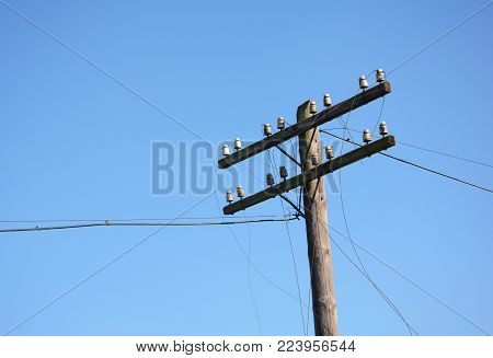 Electric post power pole. Wire breakage after hurricane. Broken power line. Hurricanes caused more damage than expected including loss of electricity for thousands of homes.
