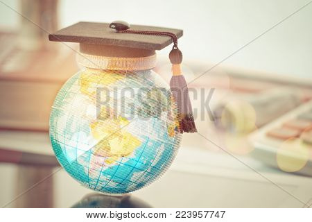 Graduate study abroad concept, Graduation cap on top Earth globe model map with Radar background. Graduate study abroad program and Back to School and Studies lead to success in world wide.