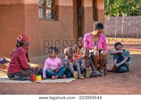 African family in front of the house in the village, Botswana