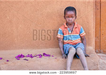 African boy in the front of the house, village, Botswana