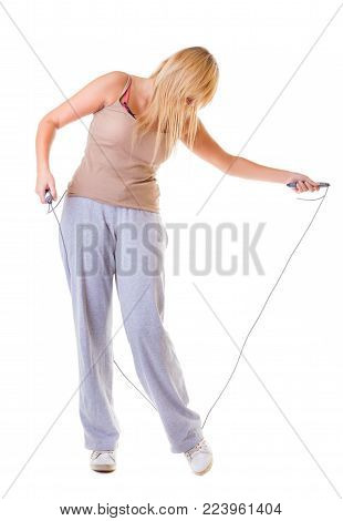 Sport girl plus size doing exercise with skip jump rope - weight loss. Fitness young woman isolated. Studio shot.