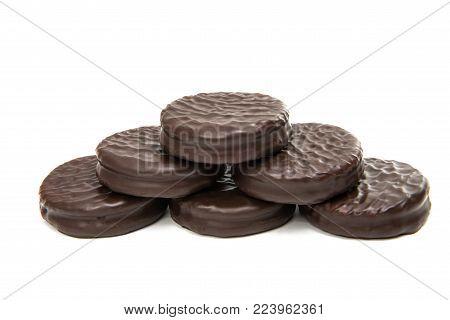 Bitten biscuit sandwich with chocolate. White background