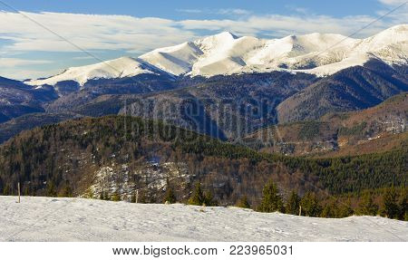 Winter landscape with Parang mountains seen from Transalpina road, Romania.