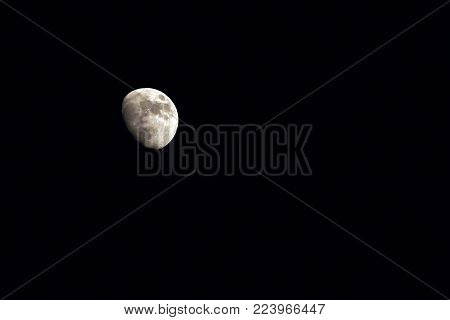 moon over dark black sky at night , moon background. Phase of the moon,  Highly detailed photo of the bright moon in the night sky