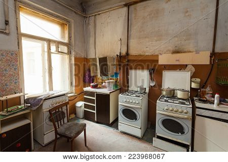 Dirty kitchen with furniture and gas stoves  is in the apartment for temporary  living (existence) refugees who were forced to migrate and emigrate from other countries.
