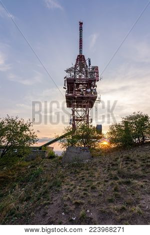 Transmitter Tower Antenna During The Sunset On Small Hill