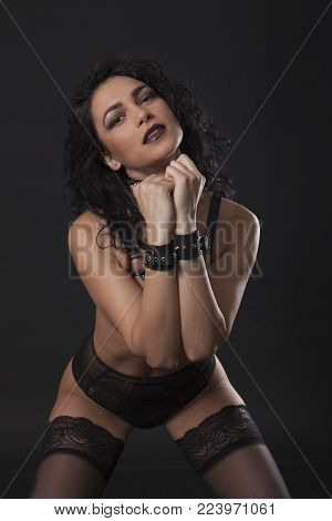 Sexy Brunette In Black Lingerie And Fetish Straps.