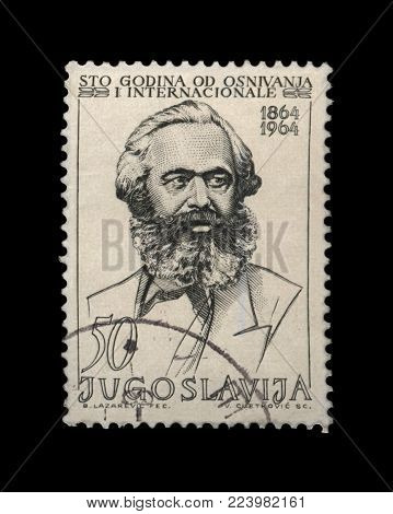 YUGOSLAVIA - CIRCA 1964: canceled postal stamp printed in Yugoslavia shows Karl Marx, famous politician leader. It  devoted to 100th anniversary of First International (aka International Workingmen's Association, 1864-1876), circa 1964.