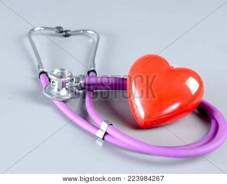 stethoscope and Red heart on white background. Selective focus