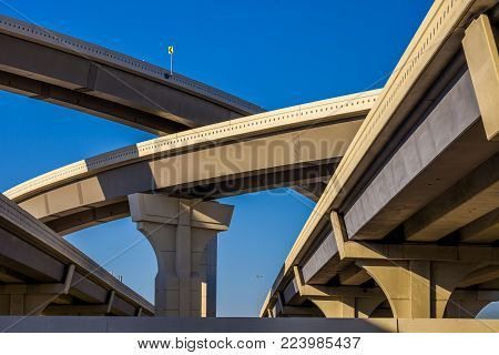Section of elevated highway with several levels against a bright blue sky Houston, Texas