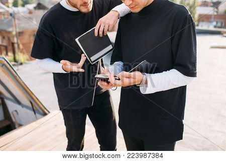 Surfing the web for information. Modern technology. Man using tablet. Students education homework concept
