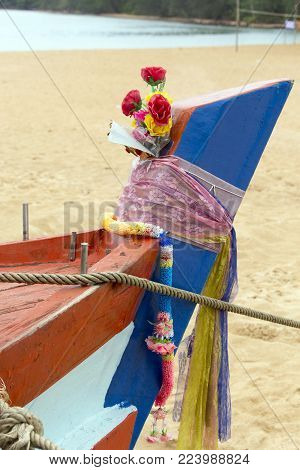 Sihanoukville, Cambodia - April 29, 2014: religious offer on a boat