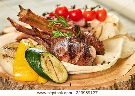 Rack of lamb with side dish. Rack of veal barbecue with garnish.