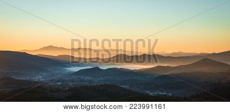 Foggy Landscape At Sunset In  Mountains Of Greece