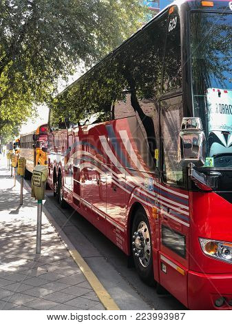 PHOENIX, AZ, USA - DECEMBER 14, 2017:  Charter and school buses closely parked for a special event in a city downtowm