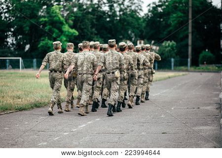 Detachment Of Marching Soldiers On The Street