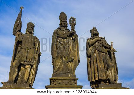 Prague, Czech Republic - December 31, 2017: The gothic sculpture of the Cyril and Methodius on the Charles bridge. Prague, medieval art, statue of Saint on the bridge of King Charles.