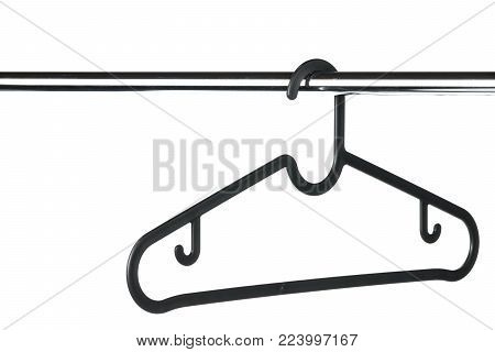 Empty black coat hanger / clothes hanger on a clothes rail with a white background. Potential copy space above and to the left of hanger.