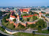 Poland. Skyline panorama of Cracow old city with Wawel Hill,  Cathedral, Royal Wawel Castle, defensive walls, park, promenade and unrecognizable walking people. poster