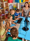 Children computer class us for education and video game. Boys and girls in children's club who spend many hours behind computer monitor harmful to health. Online training. poster